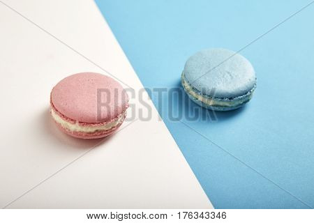 Traditional french colorful macarons on colorful background