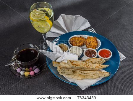 Oriental Indian Set,  Naan Bread And Onion Bhaji, Four Sauces, Blue Plate, Black Coffee, Water With