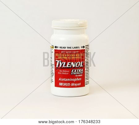 New York December 02: A bottle of Tylenol pain reliever pills isolated on white.