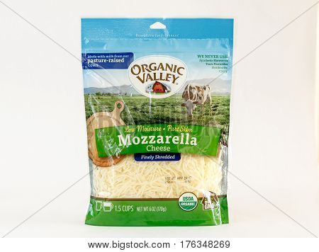 New York, December 17, 2016: A pack of Organic Valley grated mozzarella cheese is seen against white background.