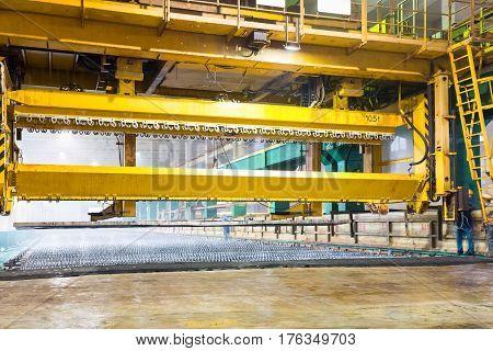 travelling crane closeup in zinc electrowinning workshop