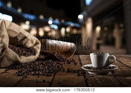 Background of cup of coffee beans with jute bag and bailer
