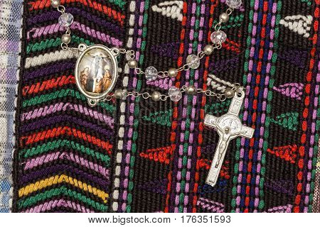 A Rosary on a Guatemalan textile tablecloth
