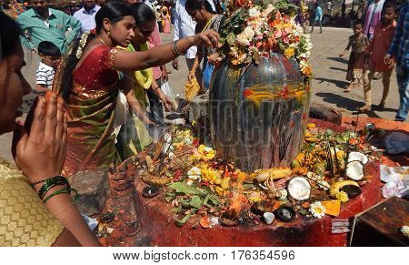 KEESRAGUTTA,HYDERABAD,INDIA-FEBRUARY 24:Hindus perform Puja to lord Shiva stone statue, near the temple, in Mahasihvaratri fesival on February 24,2017 in Hyderabad,