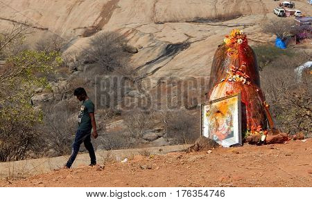KEESRAGUTTA,HYDERABAD,INDIA-FEBRUARY 24:Hindus perform Puja to lord Shiva stone statue, near the temple, in Mahasihvaratri fesival on February 24,2017 in Keesara,India.