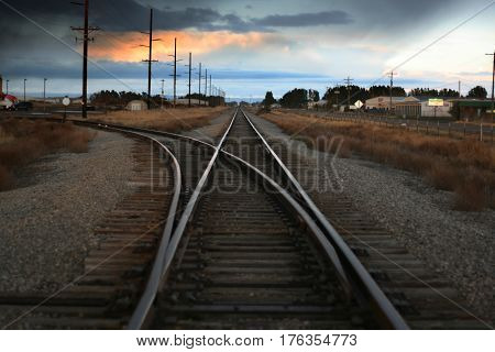 a photo of train tracks at an intersection
