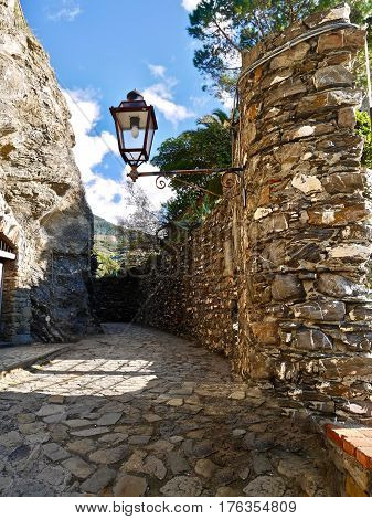 Street lamp on stone wall in Cinque Terre National Park. Monterosso al Mare. Italy