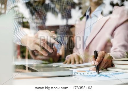 Sales team discussion process.Business crew working with new startup project.Notebook tablet wood table using devices.Creative Idea presentation.Analyze market stock.Blurred background film effect.