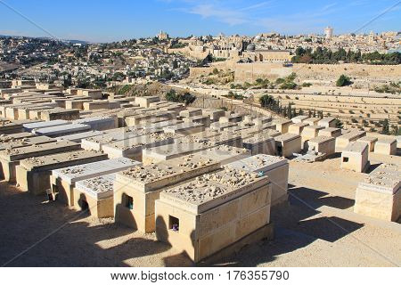 Dormition Abby and al-Aqsa Mosque in a panoramic view of Jerusalem from a cemetery on the Mount of Olives beside the Kidron Valley.