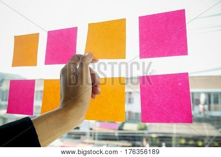 Note paper reminder schedule board. Business people meeting and use post it notes to share idea. Discussing - business teamwork brainstorming concept