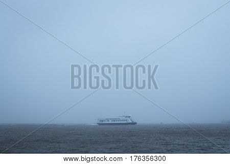 New York USA - March 14th 2017: The NY Waterway ferry boat crosses the Hudson river during snow storm Stella in New York USA.
