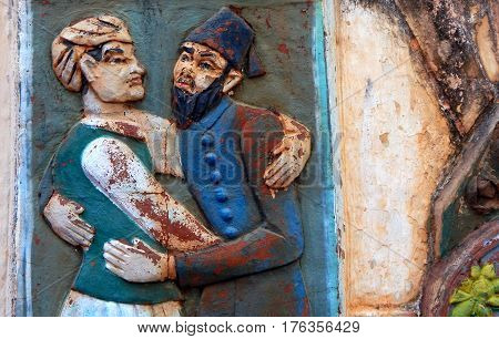 HYDERABAD,INDIA-FEBRUARY 27:Wall art of Indian Hindu and Muslim hug each other in religious tolerance and harmony in community on February 27,2017 in Hyderabad,India