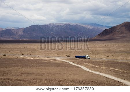 Truck driving through Nazca Desert Highway, located in the south region of Peru.