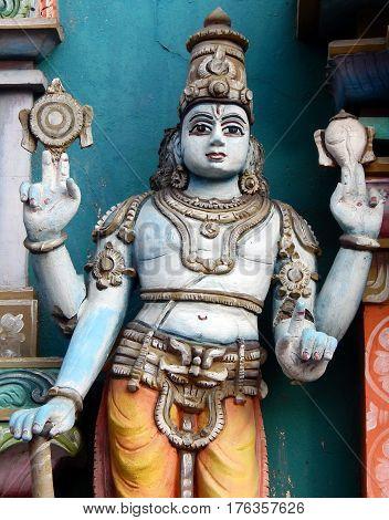 HYDERABAD,INDIA-FEBRUARY 27:Statue of Indian Hindu Dwarapalaka safe guarding, wall art on exterior wall ,temple on February 27,2017 in Hyderabad,India