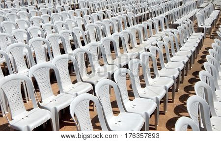 Closeup photo of empty plastic chairs in row