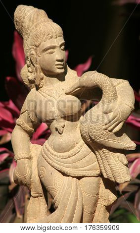 HYDERABAD,INDIA-MARCH 3:Stone carving of Indian Hindu woman, traditional architecture,carrying a duck,with details of ornaments and dress in Shilparamam on March 3,2017 in Hyderabad,India