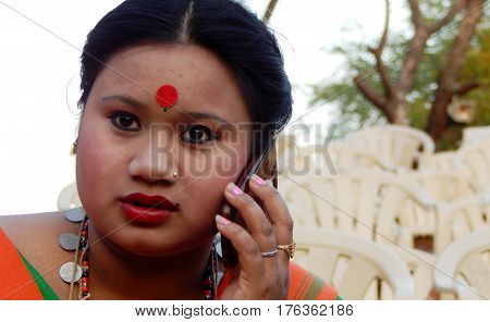 HYDERABAD,INDIA-MARCH 3:Closeup portrait of North eastern tribal woman dancer,with details of ornaments and dress in Shilparamam on March 3,2017 in Hyderabad,India
