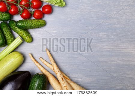 Vegetables. Cucumber, tomatoes and celery. Eggplant, squash marrow and zucchini. Organic food with copy space.