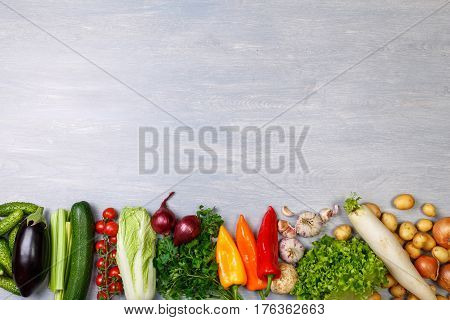 Vegetables. Tomato, cucumber and parsley. Celery, zucchini and eggplant. Potatoes, onion and garlic. Pepper, brocoli and salad, squash. Organic food with copy space.
