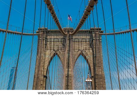 Close up view of the Brooklyn Bridge in New York NY one of the oldest suspension bridges in the United States with people on the bridge