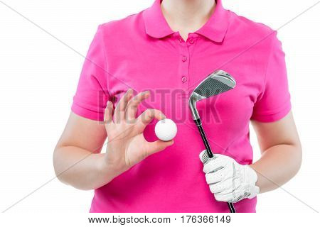 Golf Ball And Golf Club In The Hands Of The Player Close-up In Studio