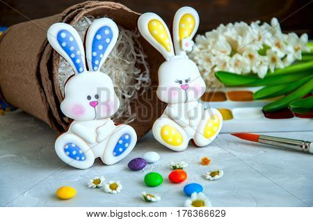 Decorated Easter Bunny Cookies Paints And Brushes Peat Flower Pots Coloful Candies Camomiles Hiacint