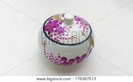 The porcelain canister on white background .