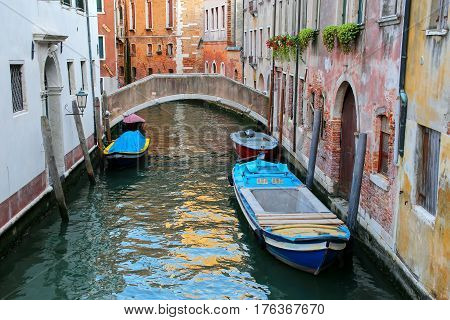 Boats Moored In A Narrow Canal In Venice, Italy