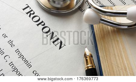 Document with title troponin on a table.