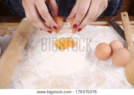 Woman Breaking An Egg.