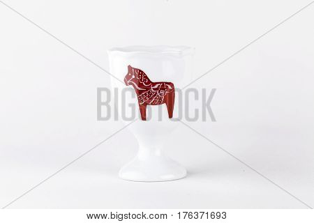 UMEA, SWEDEN ON JANUARY 08. Close up on a porcelain eggcup with ornament, artwork on January 08, 2014 in Umea, Sweden. White background. Illustrative Editorial.