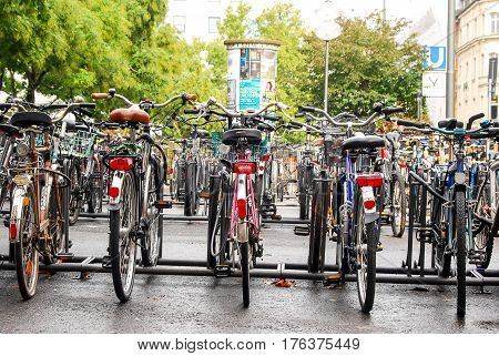 Munich,Germany-October 23,2009: Bycicles stand chained at stands next to a subway station