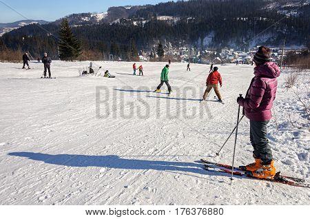 Slavske Ukraine - January 30 2017: People skiing on mountain in ski resort Slavske Carpathians. Sunny winter day