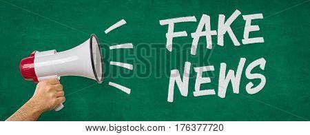 A man holding a megaphone - Fake News