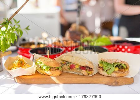 Varieties of home made sandwiches beeing sold outdoor on street stall on Open kitchen international food festival event. Street food ready to serve on a food stall.