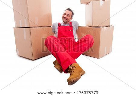Mover Man Sitting Down Relaxed Surrounded By Boxes