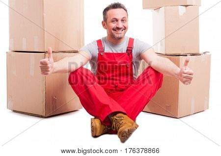 Man Sitting Down Surrounded By Boxes Showing Like
