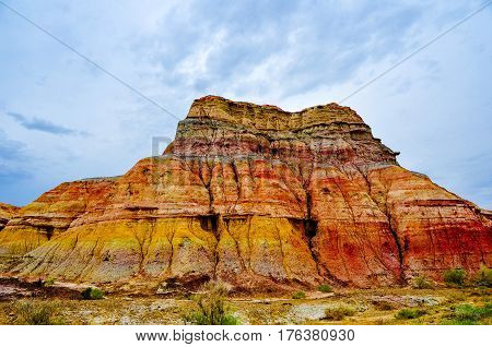 This colorful city is actually colorful mountain, a wind-eroded geological wonder in north Xinjiang province of China. Colorful city is the local people say Flaming Mountain.