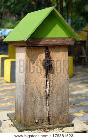 The wooden beehive with a green roof, outdoor