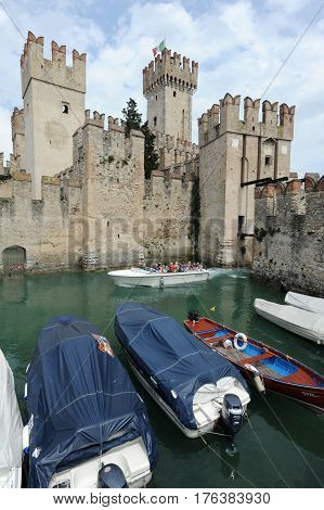 Sirmione, Italy - 9 July 2012: The castle of Rocca Scagliera at Sirmione on lake Garda, Italy