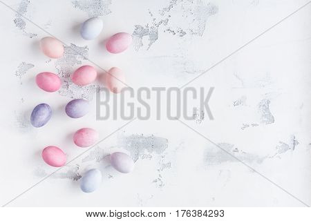 Painted easter eggs on white background. Easter concept. Holiday background. Flat lay top view copy space