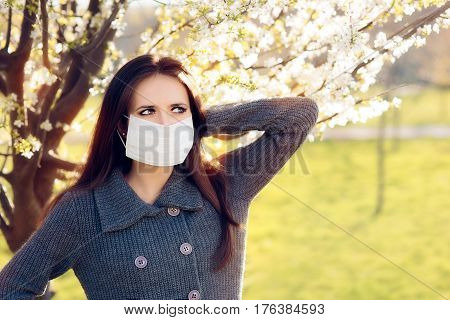 Woman with Respirator Mask Fighting Spring Allergies Outdoor