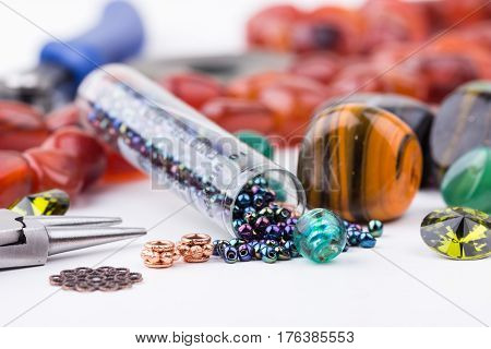 Semi-precious stone beads crystals glass and seedbeads for making jewelry. Selective focus. poster
