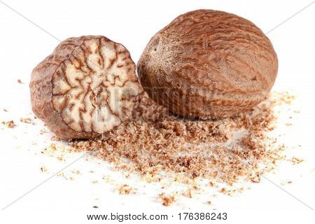 Two nutmeg and powder isolated on white background.
