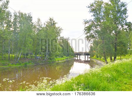 View of Slavyanka River on the outskirts of St. Petersburg at cloud summer day Russia.
