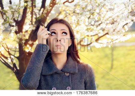 Woman with Spring Allergies Using Eye Drops