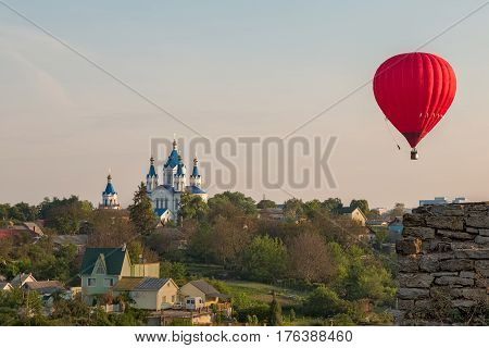 Hot air balloon over the field with blue sky aeronautics