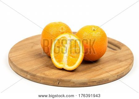 Sliced Oranges On The Wooden Board Isolated Over White With Copy Space