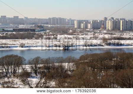 MOSCOW RUSSIA - WINTER 2013: Kapotnya and Moskva Reka Orekhovo district Uzhnie Vorota Maryno and Brateevo outskirts of UVAO Moscow Russia. View of city park and Moscow River. Morning