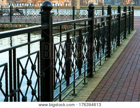 fence of wrought iron on the lake fence the lake shore